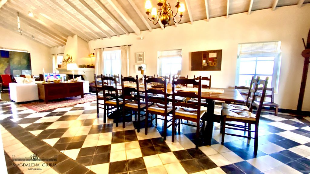 The spacious dining room with a traditional checkerboard floor