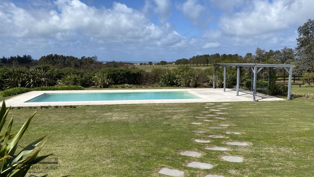 Heated pool in the park with views of the countryside and the ocean