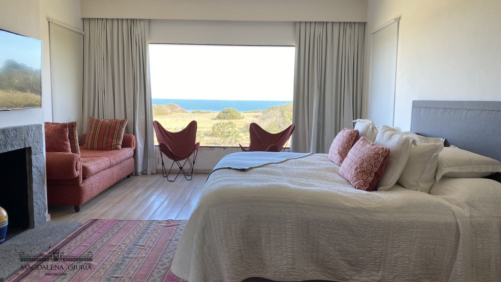 Master suite with wood burning stove, armchairs and beautiful ocean views